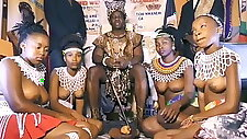 African chief with his own topless girls